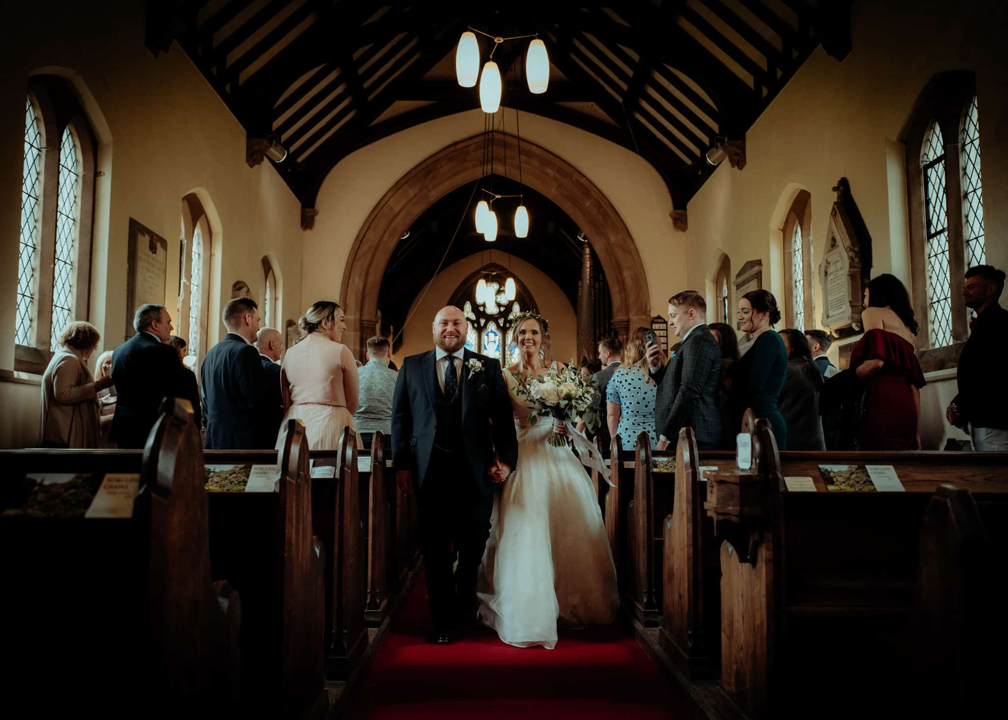 Bride & groom walk out of church