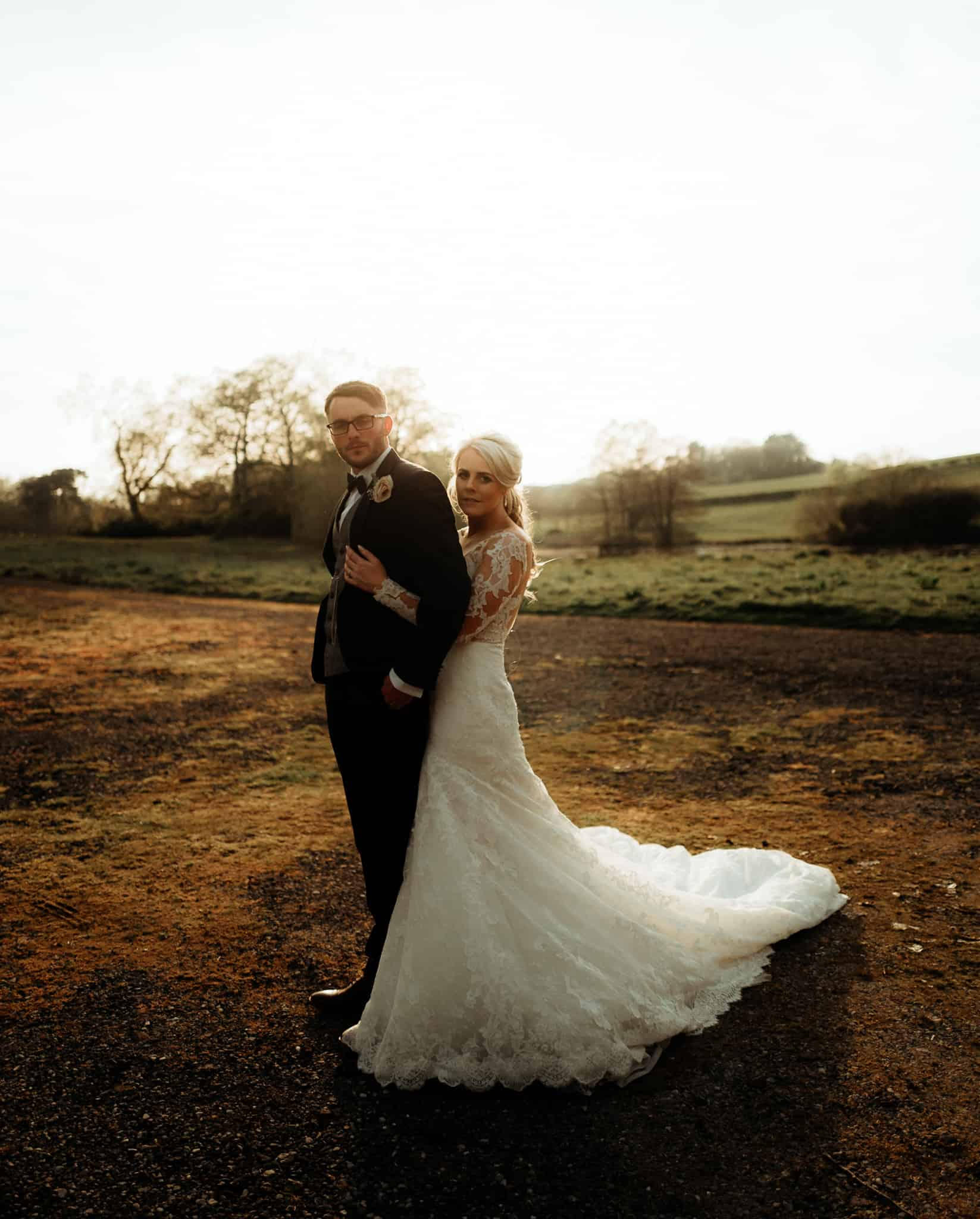 Bride & groom portraut at Delamere manor in soft golden light