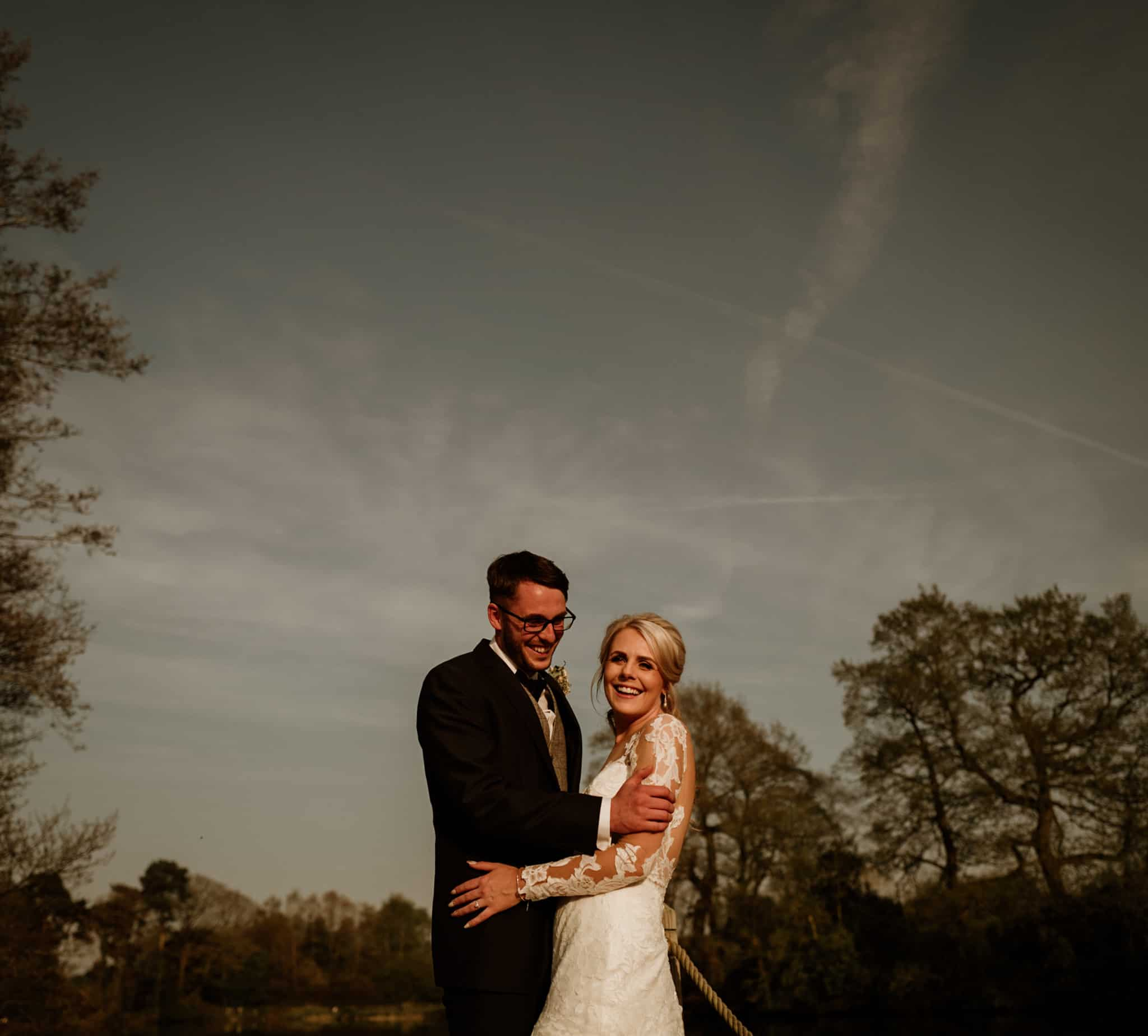 bride & groom laughing at cheshire venue