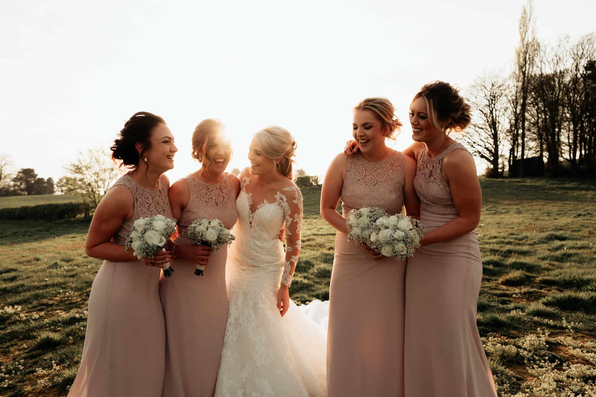 Bridesmaids kissed by the soft evening sun