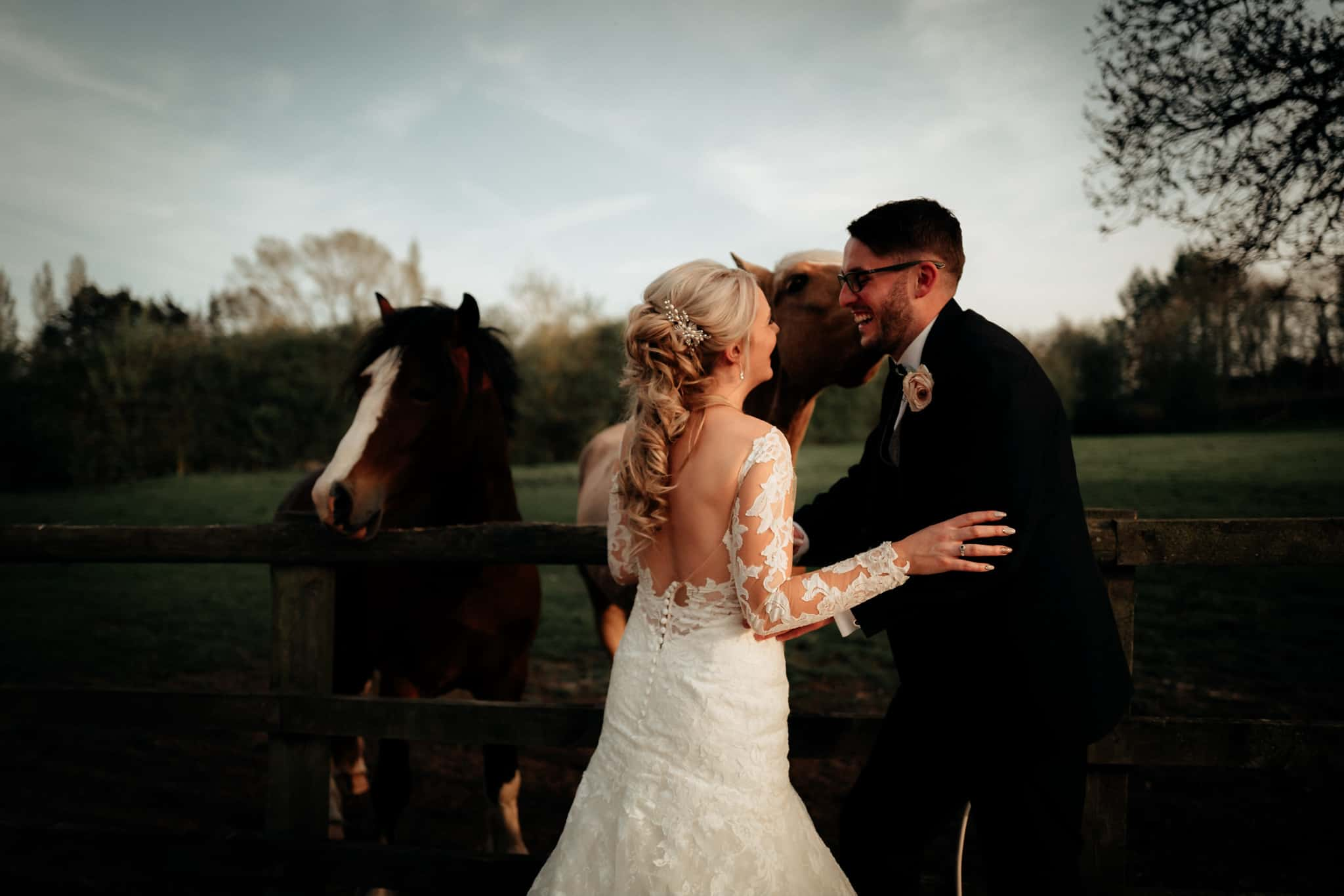 bride and groom with horses at Delamere Mano