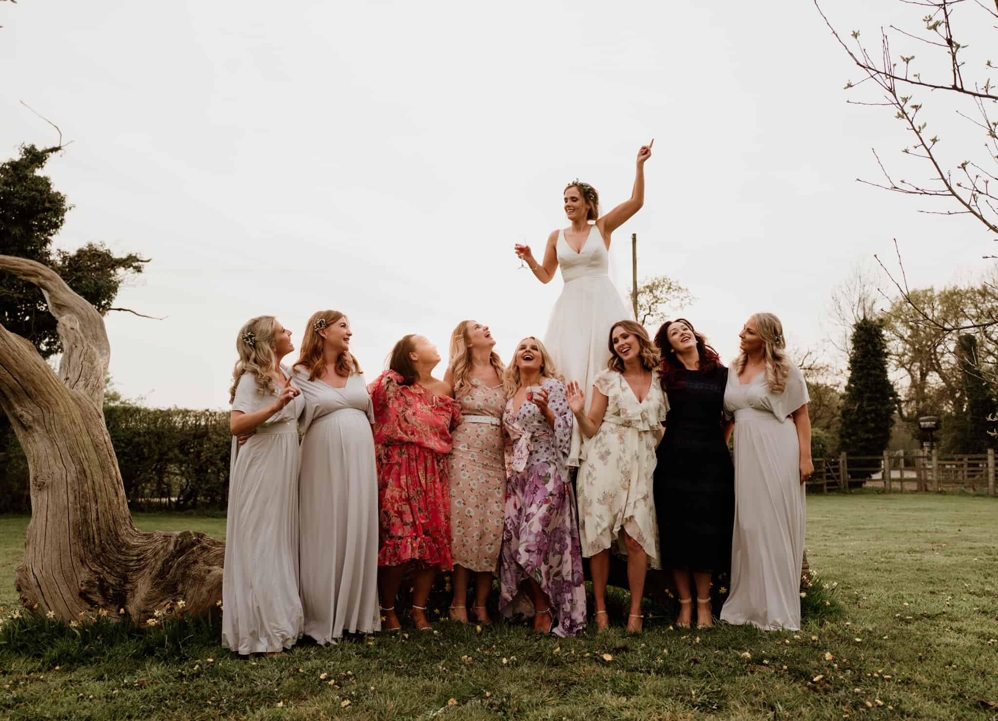 bride fooling around with her best friends